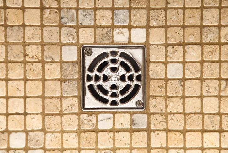 contoh lubang shower yang kerap tersumbat karena kotoran seperti rambut  dan plastik (sumber: schluter.com)