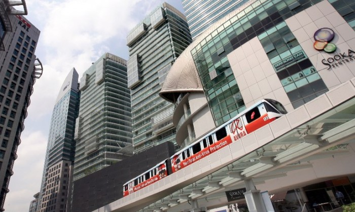 A Light Rain Transit (LRT) train passes the KL Sentral building in Kuala Lumpur on November 22, 2010. Malaysia's central bank was expected to release its third quarter GDP figures later in the day following strong growth in the first half of the year.   AFP PHOTO