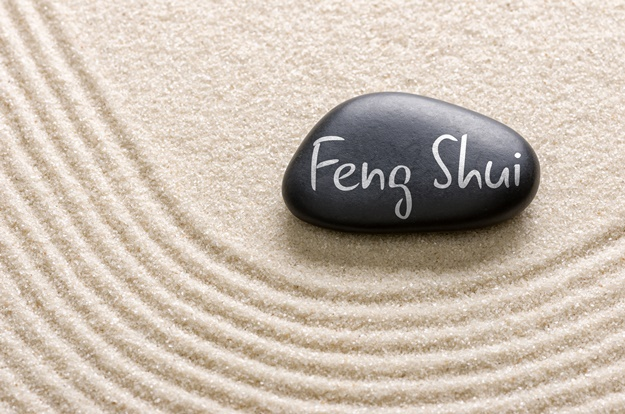 A black stone with the inscription Feng Shui