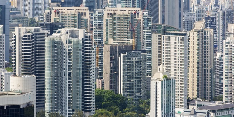 Aerial view of crowded Singapore highrise apartment skyscraper buildings