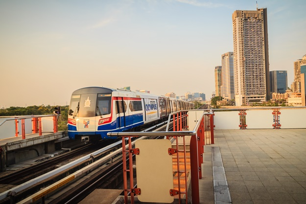 BTS sky train is driving to the platform at Mochit BTS station.