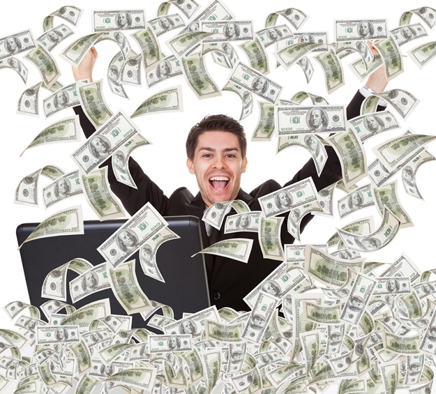 Portrait of successful young businessman with money rain