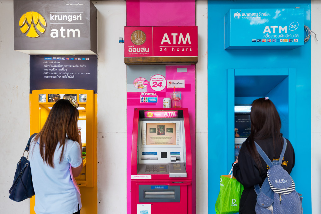 two girls at ATM in Thailand