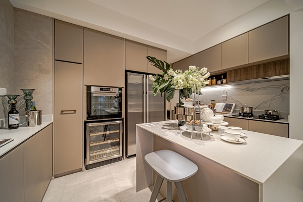 The Atelier features a functional kitchen island design for preparing food and entertaining guests. Photo: