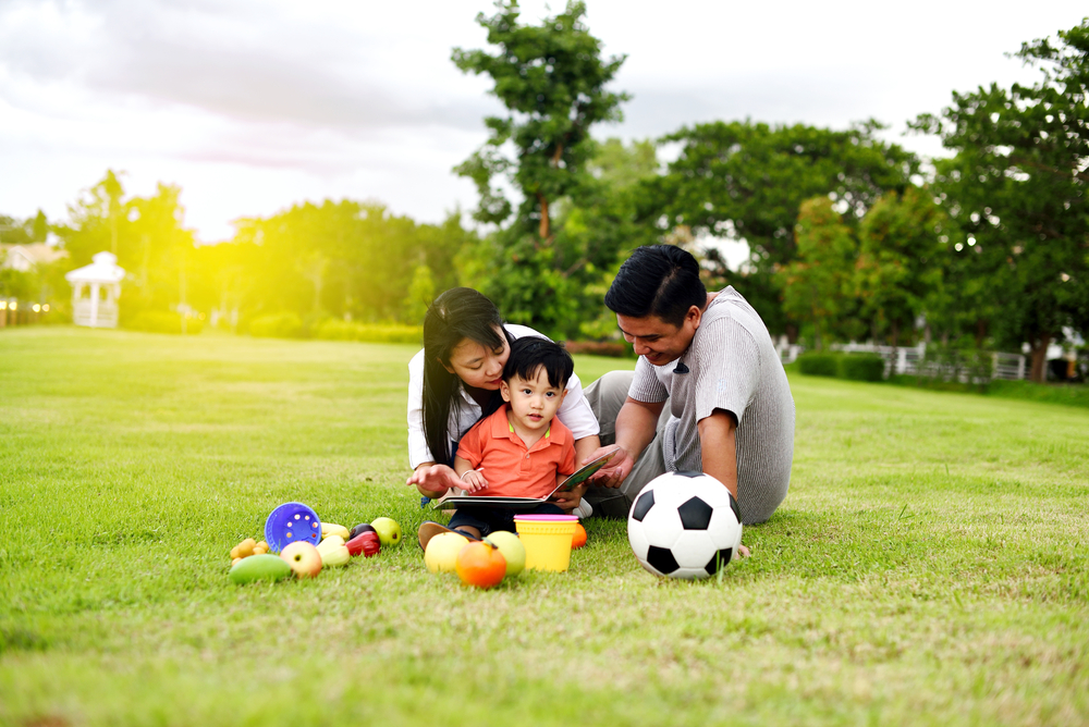 Father,And,Mother,Play,With,Their,Son,In,The,Garden,