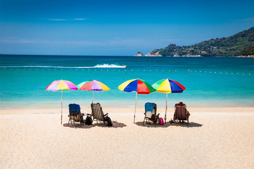 Tourists,At,Patong,Beach,In,Phuket,,Thailand.,Phuket,Is,A