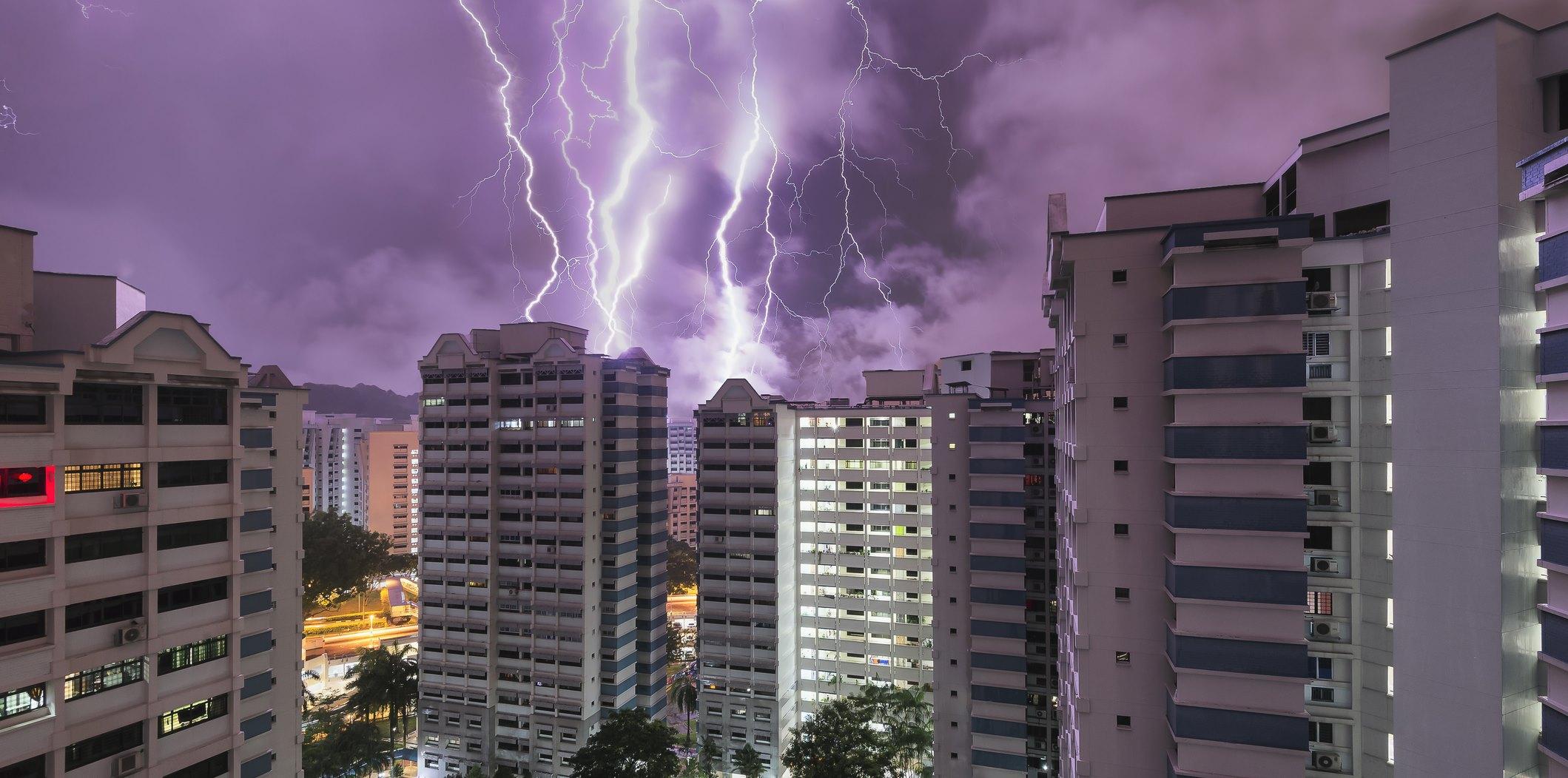 Singapore HDB flat and thunderstorm at night