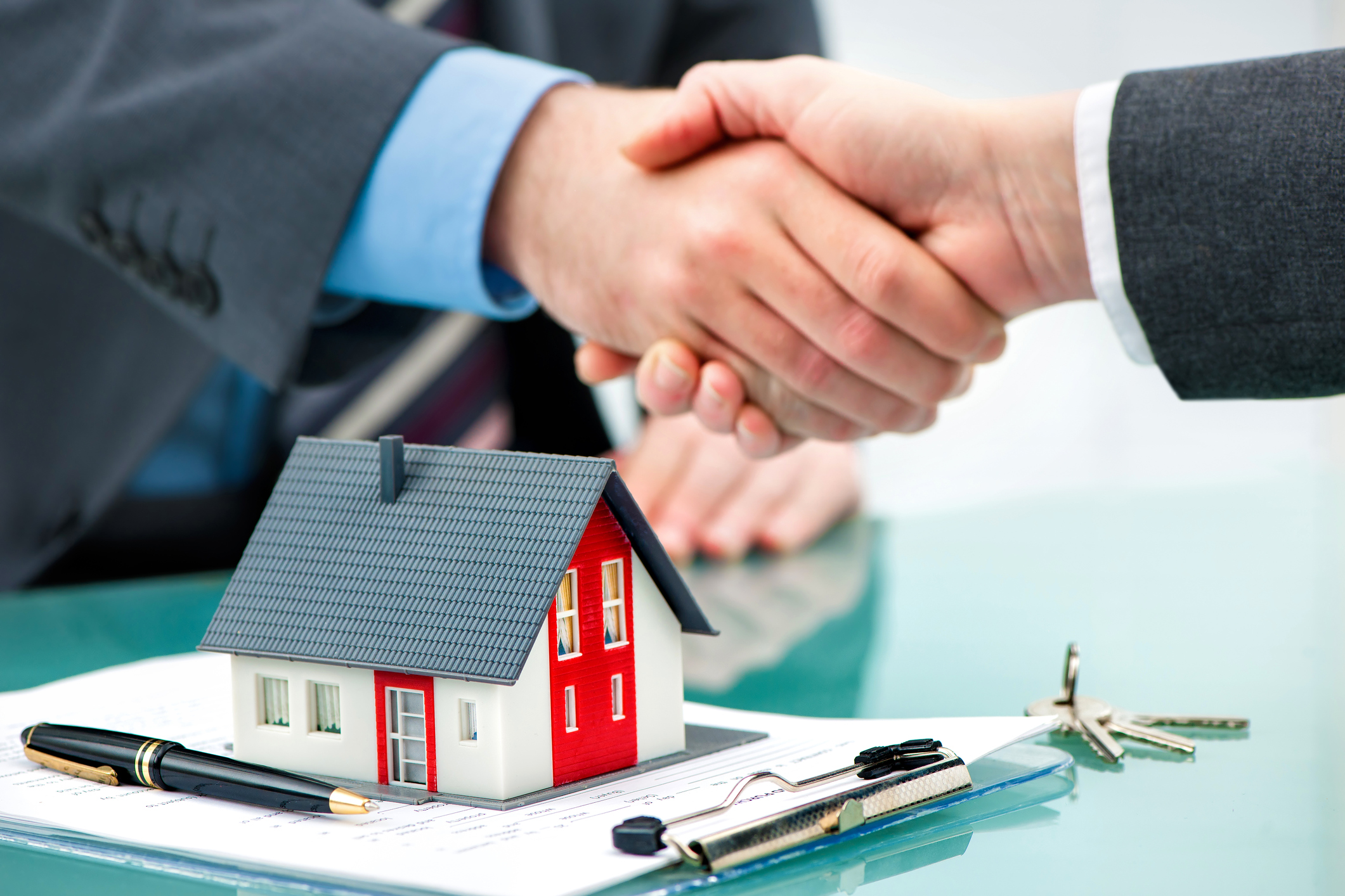 Estate agent shaking hands with customer after contract signature Contract buy sell house