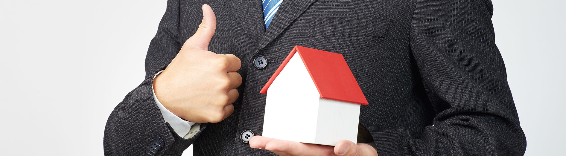 68285851 - businessman holds tablet with house model miniature