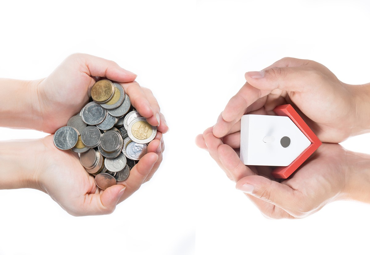 Buying house concept with giving money and key