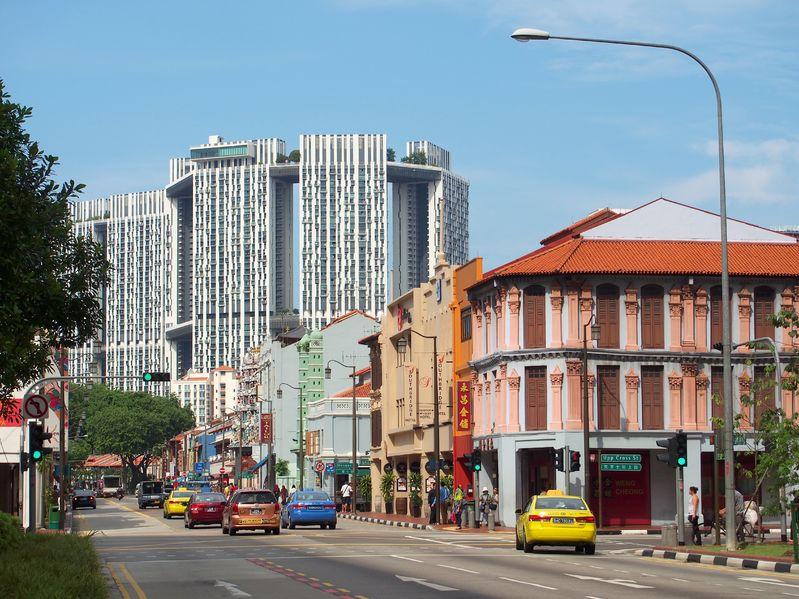 Pinnacle towers over nearby shophouses - PropertyGuru Singapore