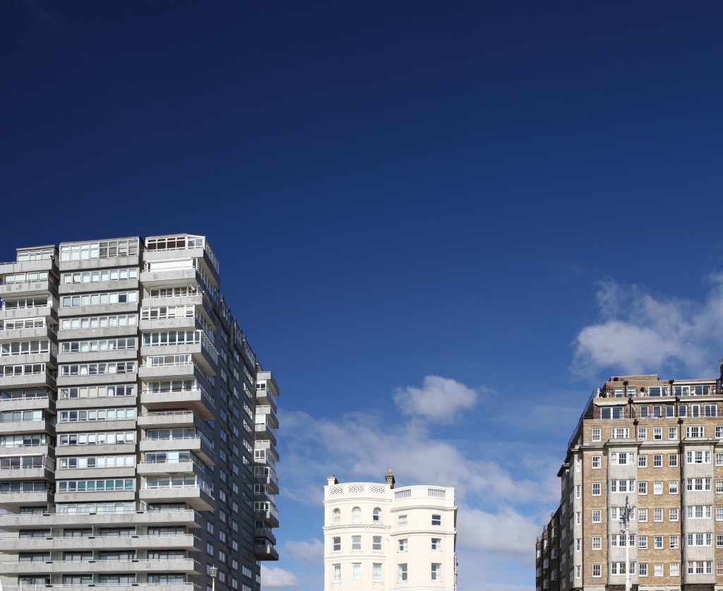 6845159 - tower block modern and classic against blue sky. offices, flats or apartments from three different time periods