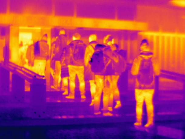 Infrared picture of a crowd during rush hour - PropertyGuru Singapore