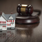 Gavel and Small Model House on Wooden Table home condo law