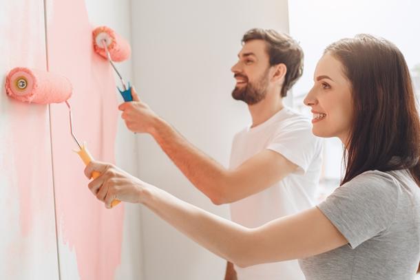 Young couple doing apartment repair together themselves สีทาบ้านช่วยเสริมฮวงจุ้ย