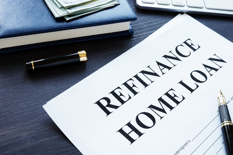 Refinance home loan form, pen and money.