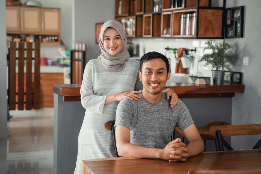 muslim couple sitting in dining room together