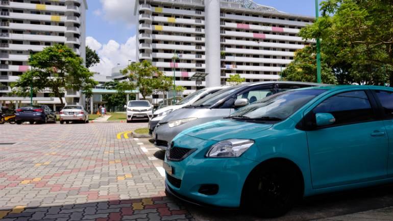 cars parked at a surface HDB car park