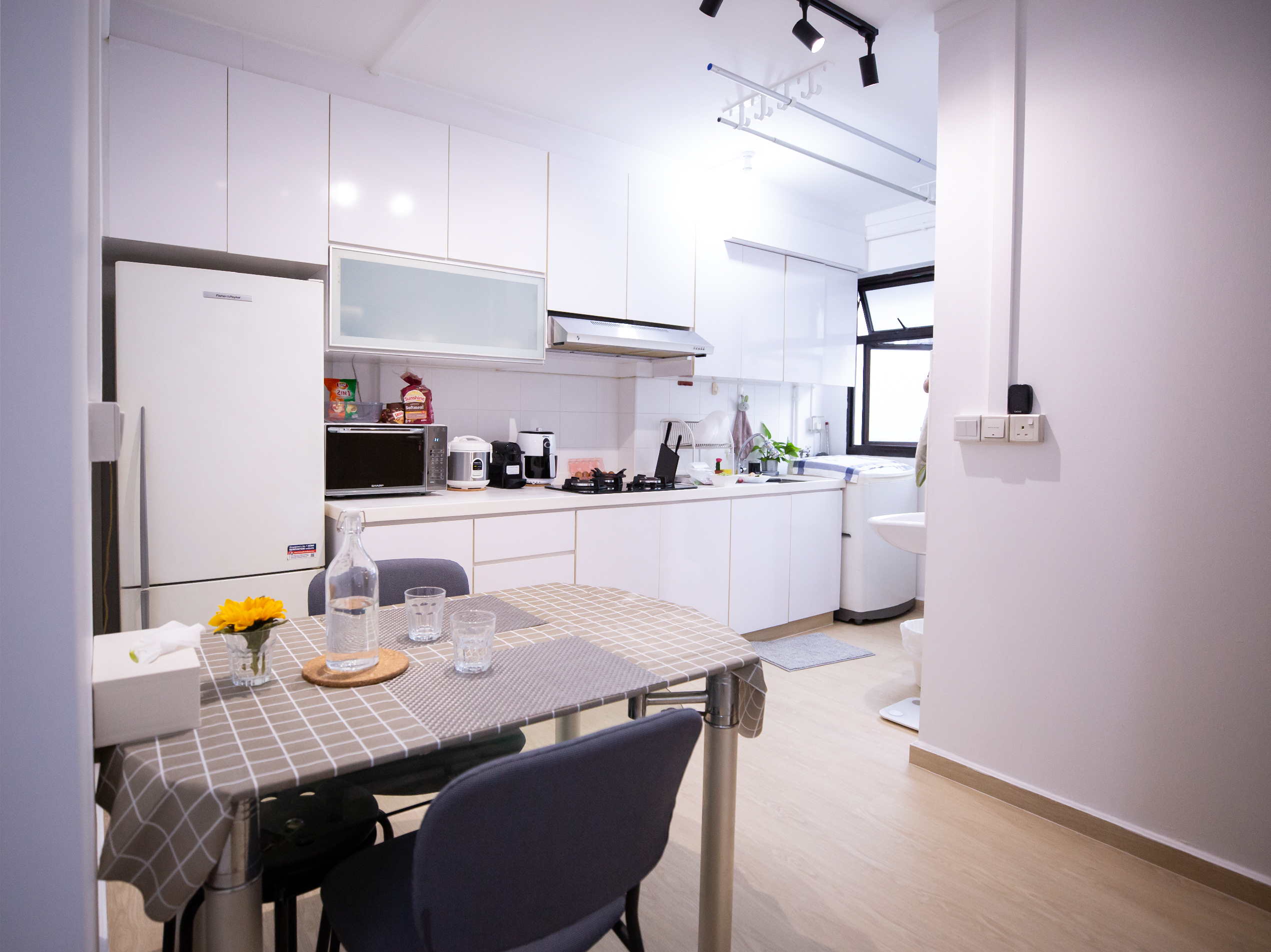 Kitchen and dining area of Derrick and Patricia's HDB resale flat in Yishun