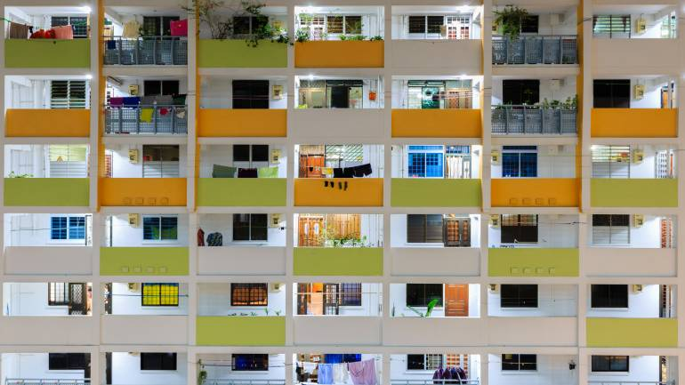 The front section of a colourful HDB block