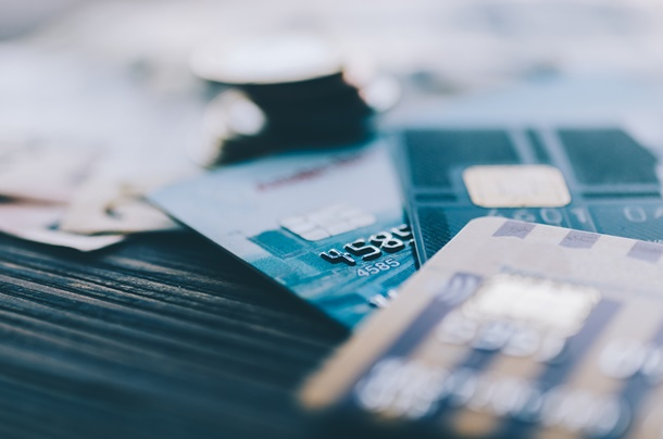 Credit card, coins and money on the table