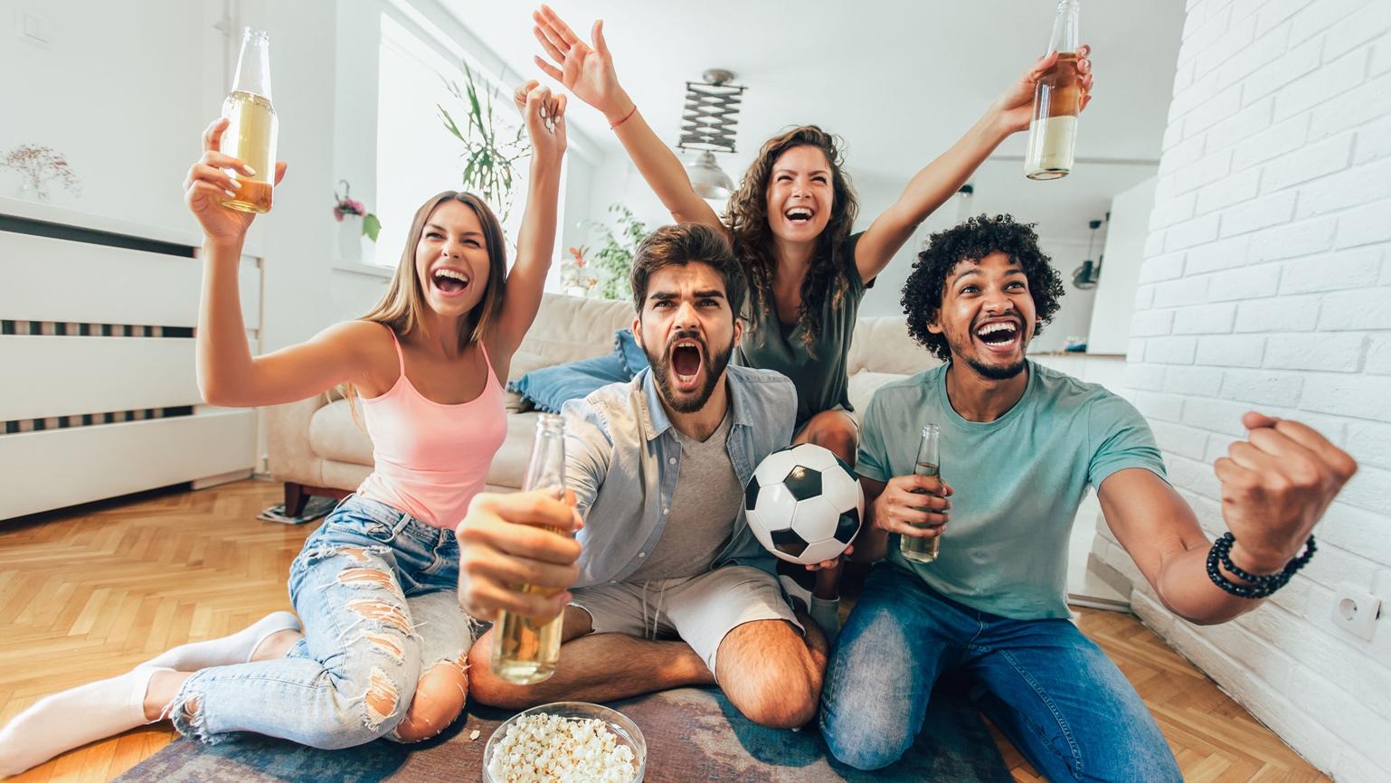 Football fans watching football at home