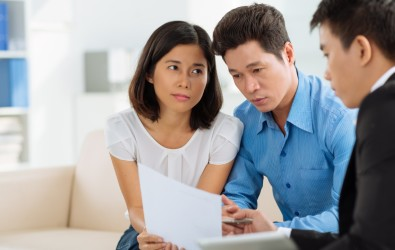 A loan officer going through a loan document with home loan applicants