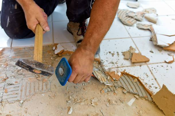 Floor tiling being hacked during renovation works