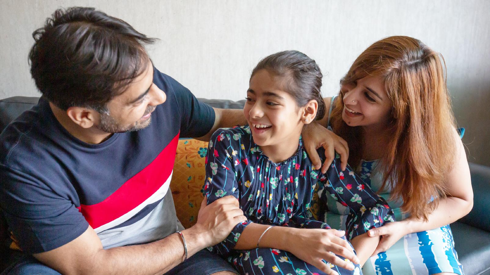 Esha, her husband, Prashant, and daughter Raya
