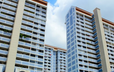 White and light-blue HDB flats in the day