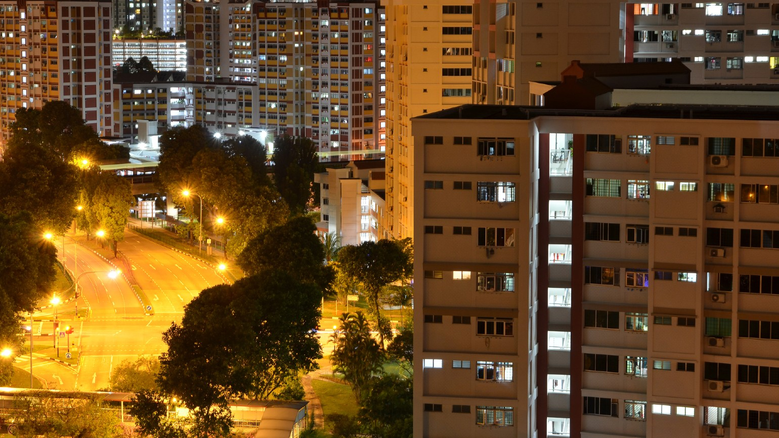 HDB flats at night by a road