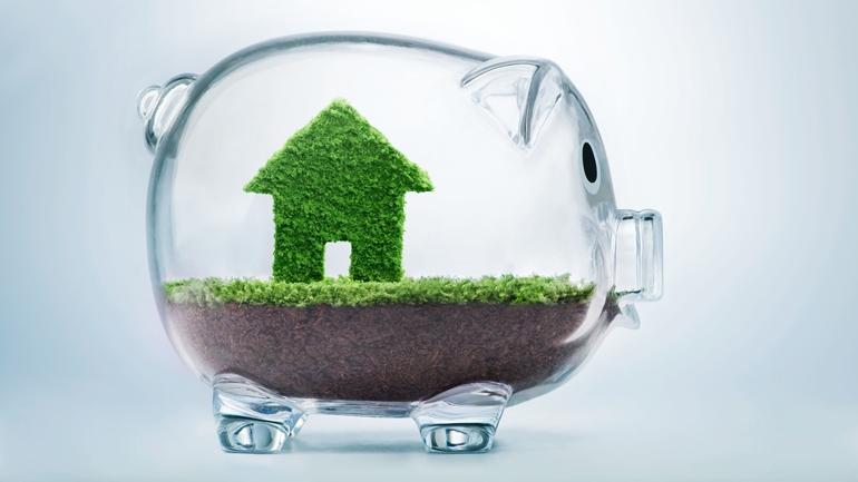 Saving to buy a house or home savings concept