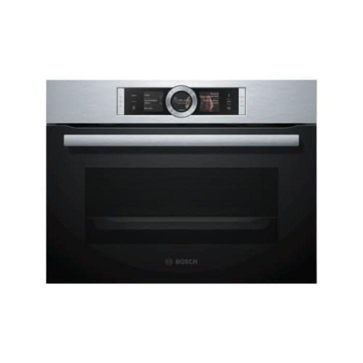Caption: Oven listrik Bosch memiliki teknologi uap yang menjadikan makanan renyah di luar dan tetap juicy di dalam. (Foto: Tokopedia)
