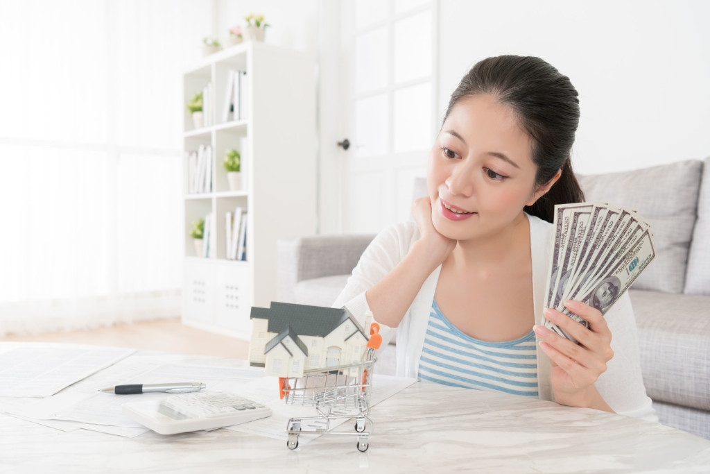 housewife holding account savings banknote cash