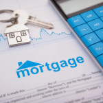 An empty mortgage application form with house key