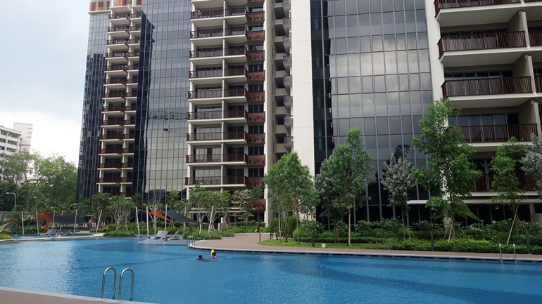 what is an executive condo and how do you buy one