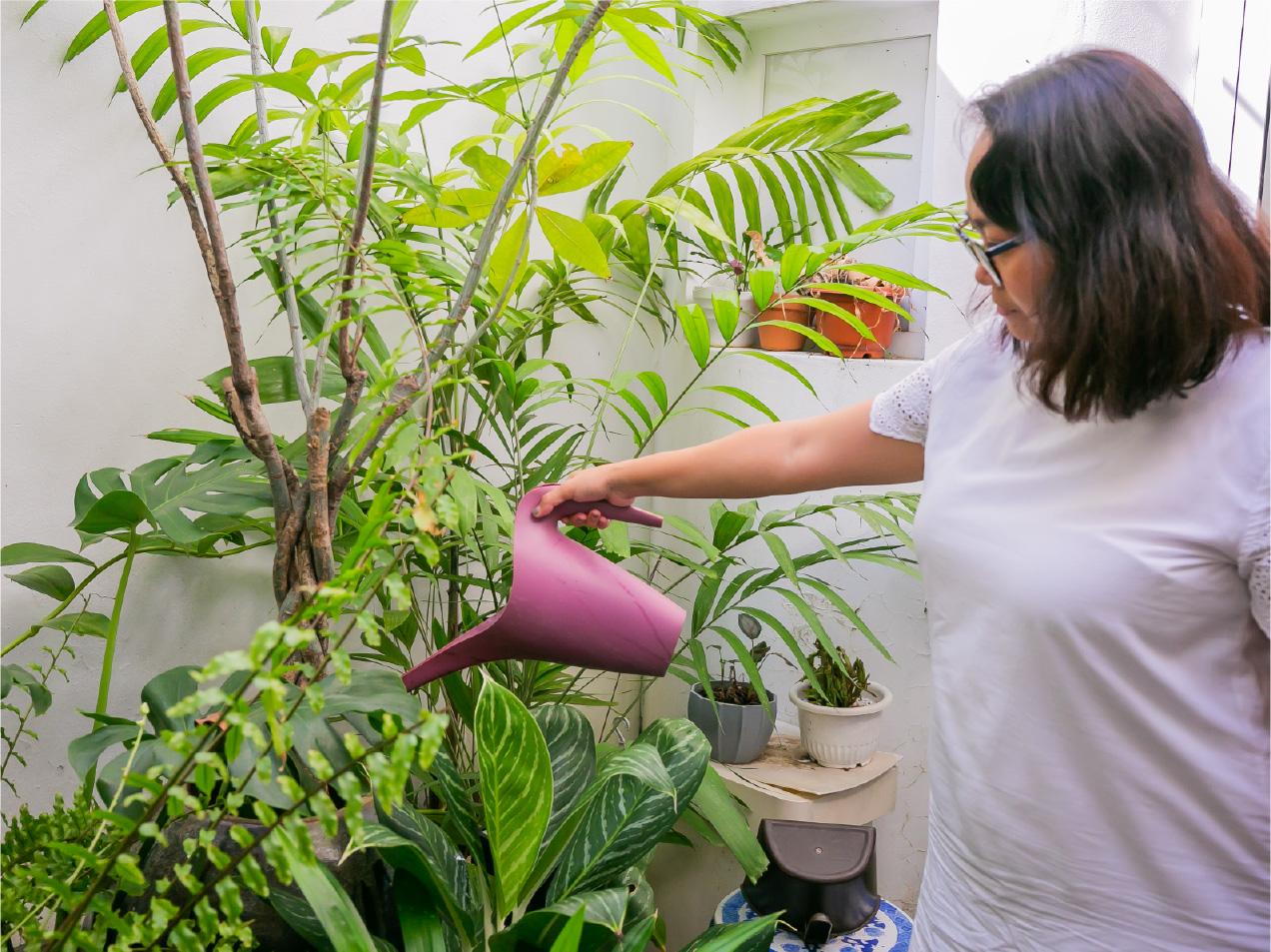 Sherry Ann watering plants