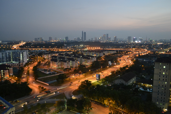 Johor Bahru shines as a bustling city in the darkness.